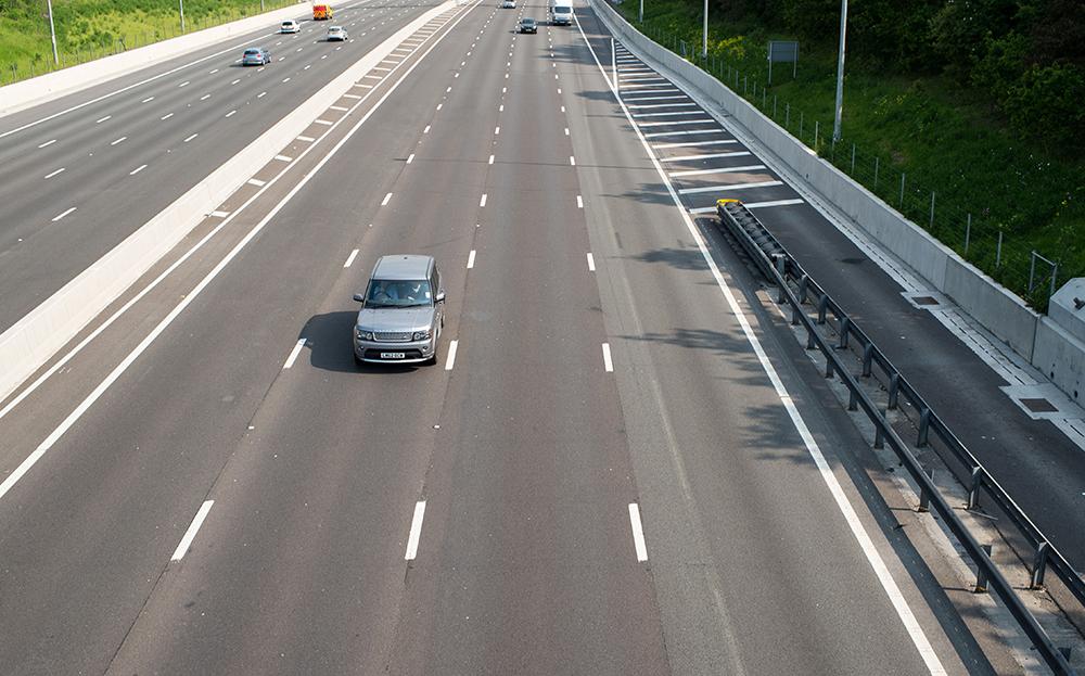 Motorway showing a car hogging middle lane
